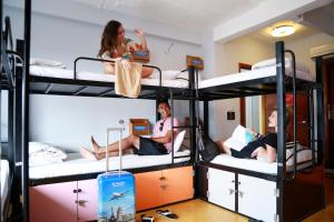 A bunk bed or bunk beds in a room at Vietnam Backpacker Hostels - Downtown