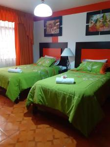 A bed or beds in a room at Amaru Hotel Huaraz