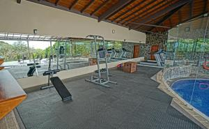 The fitness center and/or fitness facilities at El Establo Mountain Hotel