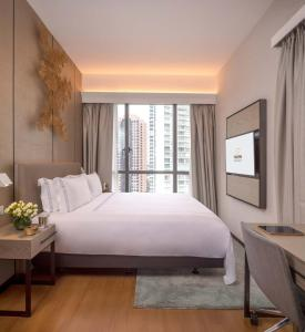 A bed or beds in a room at Fraser Residence Orchard Singapore (SG Clean)