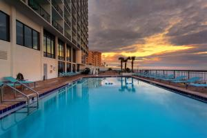 The swimming pool at or near Holiday Inn Express & Suites Oceanfront Daytona Beach Shores, an IHG Hotel