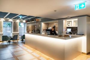 The lobby or reception area at Catalonia Porto
