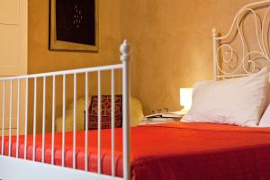A bed or beds in a room at Castello Oldofredi