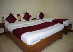 A bed or beds in a room at Manas Homestay by Sky Stays