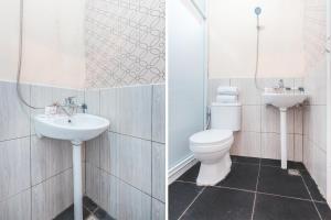 A bathroom at Vaccinated Staff - OYO 1868 J&b Room Pramuka