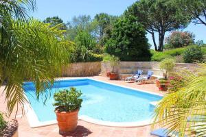 The swimming pool at or near Quinta do Lago Villa Sleeps 8 Pool Air Con WiFi
