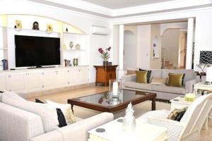 A seating area at Quinta do Lago Villa Sleeps 8 Pool Air Con WiFi