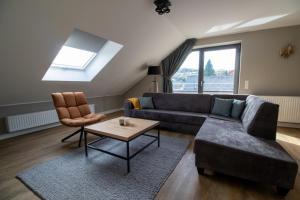 A seating area at UplandParcs Bergblick