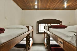 A bed or beds in a room at Hostel Chocolatchê