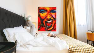 A bed or beds in a room at Joya del Casco Boutique Hotel by Shiadu