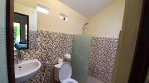 Ein Badezimmer in der Unterkunft Timbis Homestay Bali