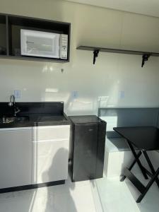 A kitchen or kitchenette at Container no Vale dos Vinhedos em Bento Gonçalves