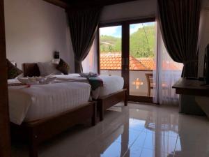 Ein Bett oder Betten in einem Zimmer der Unterkunft Crystal Bay Bungalows