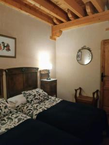 Cama o camas de una habitación en La Forqueta y El Fontanal