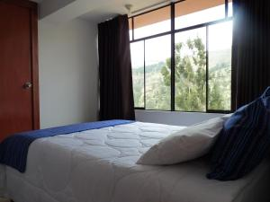 A bed or beds in a room at HAMAY WASI