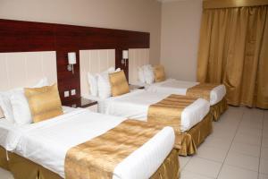 Cama ou camas em um quarto em Farha International Furnished Units 3