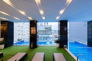 The swimming pool at or close to Red Sun Nha Trang Hotel