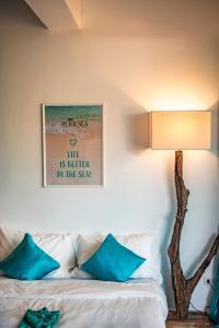Ein Bett oder Betten in einem Zimmer der Unterkunft By The Sea Koh Mak