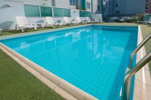 The swimming pool at or near Solis Praia Hotel Itapema