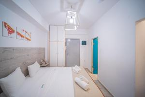 A bed or beds in a room at City Center Studios