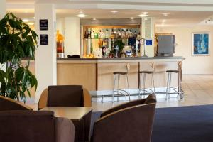 The lounge or bar area at Holiday Inn Express Cardiff Airport, an IHG Hotel