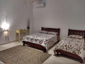 A bed or beds in a room at CHALÉ CAPOEIRA DOS MILAGRES