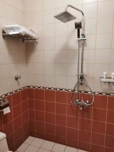 Um banheiro em Qemmat Al Rafaa