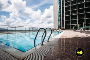 The swimming pool at or close to Luco Apartments @ Imperial Suites Kuching