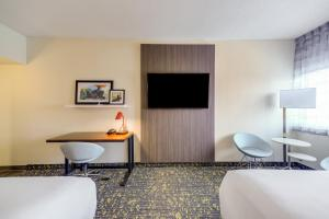 A television and/or entertainment center at Hotel RL St Louis Airport