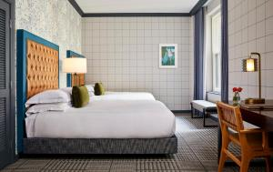 A bed or beds in a room at Kimpton Hotel Monaco Denver, an IHG Hotel