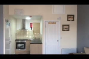 A kitchen or kitchenette at Stoke House Apartments