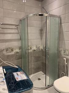 Um banheiro em Holiday Plus Hotel Suites