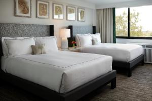A bed or beds in a room at Glover Park Hotel Georgetown