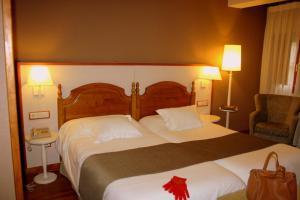 Cama o camas de una habitación en Hotel Infantado