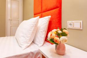 A bed or beds in a room at Laluna Hotel