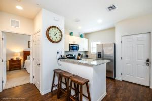 A kitchen or kitchenette at Intimate & Upscale - 4 Bdm Townhome townhouse