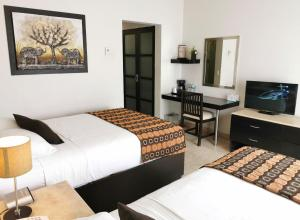 A bed or beds in a room at Coral Island Beach View Hotel