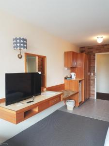 A television and/or entertainment center at All Seasons Motel Armidale