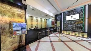 The lobby or reception area at Pearl Grand Hotel
