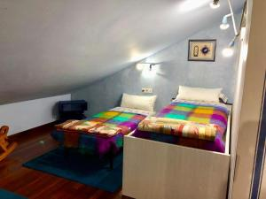 A bed or beds in a room at Chalet BILBAO- AEROPUERTO