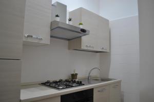 A kitchen or kitchenette at GARDENIA