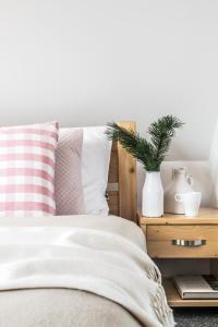 Łóżko lub łóżka w pokoju w obiekcie Villa Kaplowa Chata & SPA