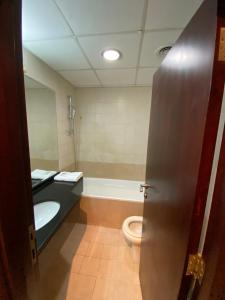 A bathroom at Cozy Upgraded 1 bedroom Hall in Dubai Silicon Oasis