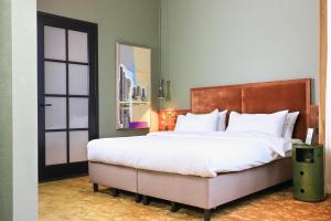 מיטה או מיטות בחדר ב-Hotel Mai Amsterdam
