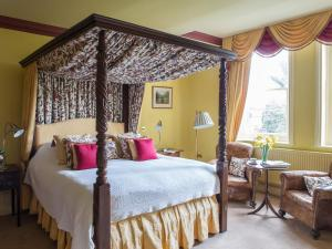 A bed or beds in a room at Gliffaes Country House Hotel