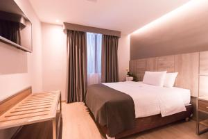 A bed or beds in a room at Surya Lima
