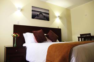 A bed or beds in a room at Hotel Ferrua