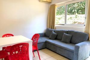 Uma área de estar em Manureva iti studio - Tahiti - Faa'a - A/C - Wi-Fi - 2 persons