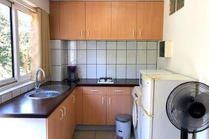 A cozinha ou cozinha compacta de Manureva iti studio - Tahiti - Faa'a - A/C - Wi-Fi - 2 persons
