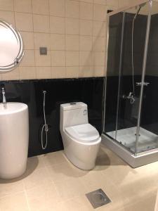 Um banheiro em Nuzol Mina 110 Hotel